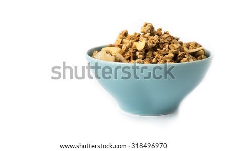 Muesli in bowl  on white background . - stock photo