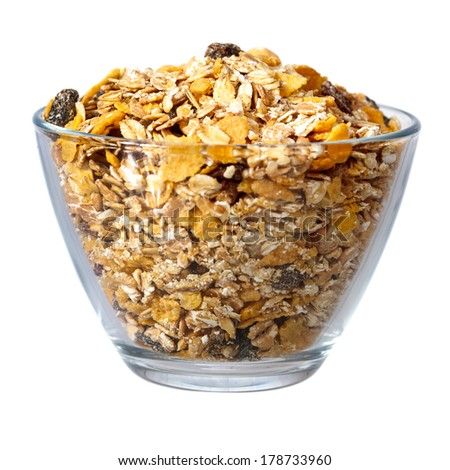 Muesli in glass bowl isolated over white background - stock photo