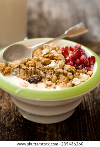 Muesli in the cup closeup on the wood backing - stock photo