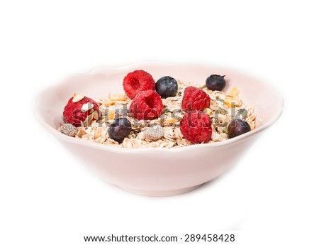 muesli with berries isolated on a white background