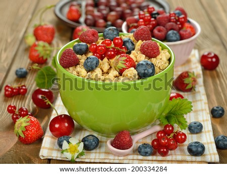 Muesli with berries on a brown background