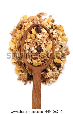 Muesli with dried fruits on wooden spoon. Isolated on white background. Directly Above.
