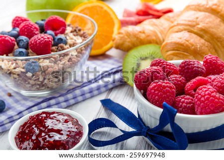 Muesli with fresh fruit on a breakfast table - stock photo