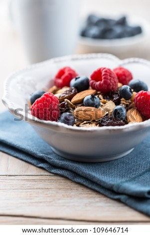 Muesli with fresh fruits and almonds - stock photo