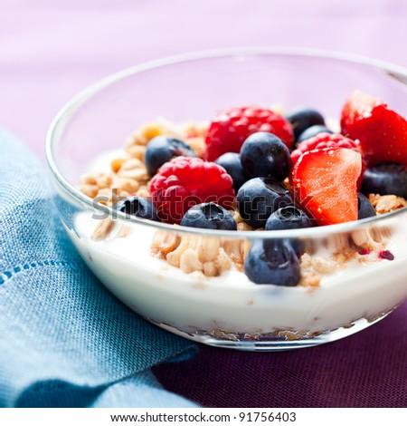 Muesli with fresh fruits and yogurt - stock photo