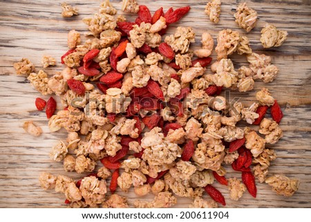 Muesli with goji berries in a wooden background. - stock photo