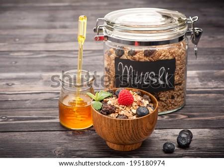 Muesli with honey, raspberries and blueberries. Healthy Breakfast - stock photo