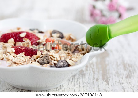 muesli with yogurt and strawberry for happy face - stock photo
