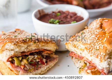 Muffalatta Sandwich with Cup of Red Beans in New Orleans Restaurant