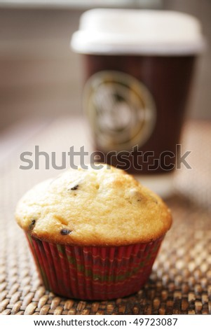 Muffin and coffee to go on a table