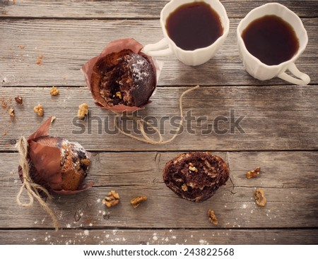 muffin with chocolate on wooden background - stock photo