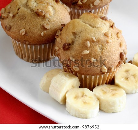 Muffins on a plate with bananas - stock photo