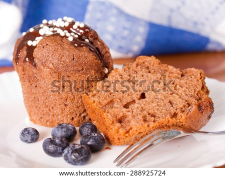 Muffins on the table and blueberries