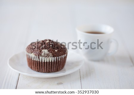 Muffins on the white wooden table