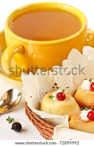 Muffins with berries  and cup of green tea.
