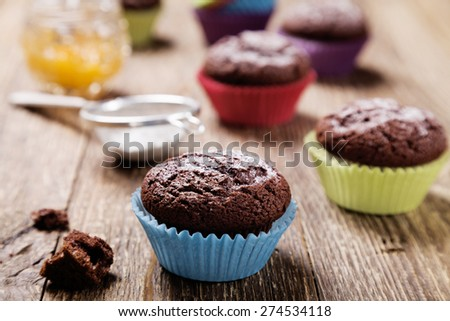muffins with chocolate in colorful molds
