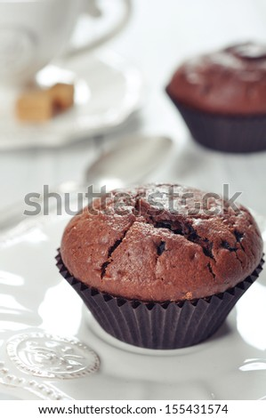 Muffins with cup of coffee and chocolate