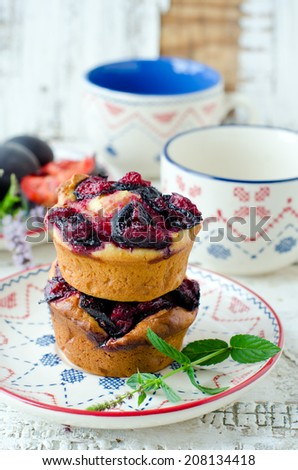 Muffins with plums - stock photo