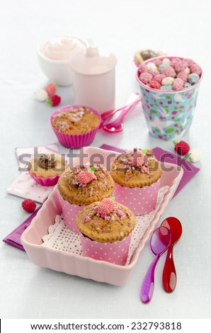 muffins with praline in a pink ceramic dish in a festive decor - stock photo