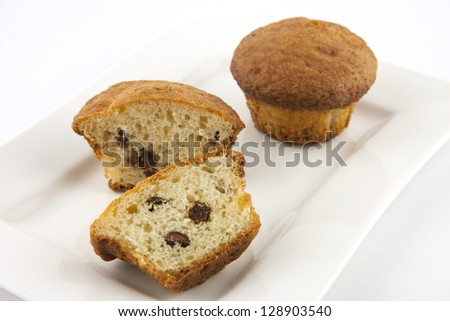 muffins with raisins on a white plate