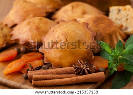 Muffins with spices on the wooden desk - stock photo