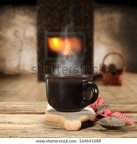 mug and interior with fireplace  - stock photo