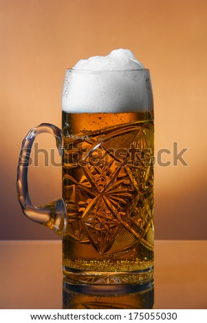 Mug fresh beer with cap of foam - stock photo