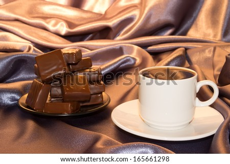 mug  hot  black coffee candle flame brown background is white cup saucer