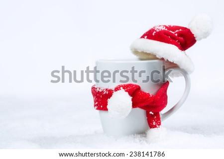[Obrazek: stock-photo-mug-in-a-cap-and-scarf-238141786.jpg]