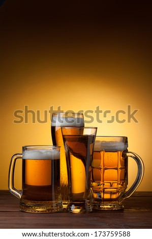 mug of beer on the table - stock photo