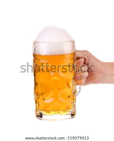 Mug of beer with foam in hand. Isolated on a white background