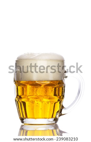 Mug of beer with foam isolated on white background - stock photo