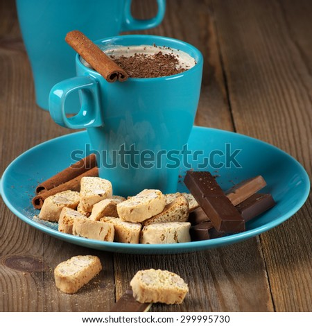 Mug of coffee latte and confectionery on rustic wooden background. - stock photo