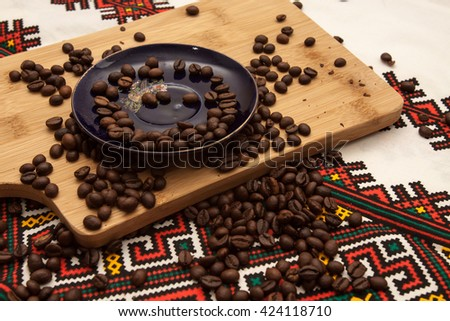 mug of coffee lying on the palm Caucasian girls coffee beans lying on a wooden background