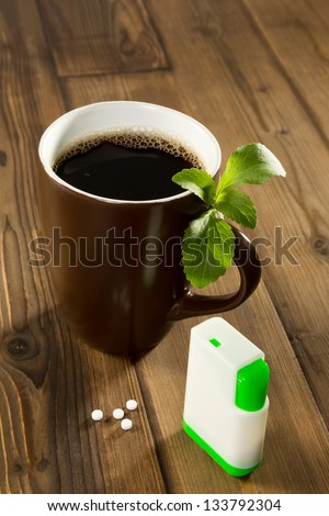 Mug of coffee with stevia tablets as natural and healthy sweetener - stock photo