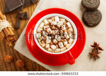 Mug of hot chocolate with marshmallow. Cocoa with cookies. Top view.