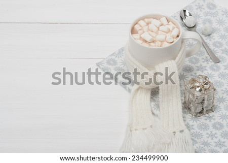 Mug Of Hot Chocolate With Scarf. Marshmallows. Christmas Decorations. Space for Text. - stock photo