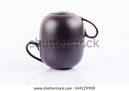 Mug stack isolated on white background. Empty coffee or tea cup with handle for hot cafe beverage.