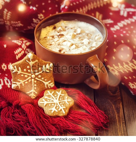 mug with hot chocolate and red christmas scarf - stock photo