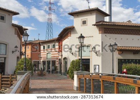 MUGELLO, ITALY - SEPTEMBER 11, 2014: People walk along McArthurGlen Designer Outlet Barberino situated in 30 minutes from Florence. McArthurGlen Group opened its first designer outlet in 1995.