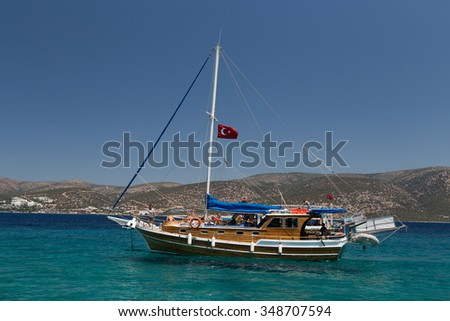 MUGLA, TURKEY - JULY 16, 2015: People have fun and relaxing in sailboat tour around Bodrum Town,  Aegean sea.