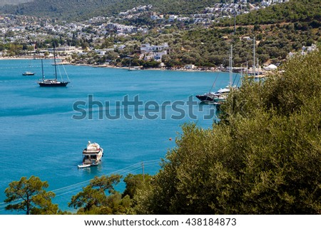MUGLA, TURKEY - MAY28, 2016 : Seascape view of coastline with blue bright sea with small hills and small boats.