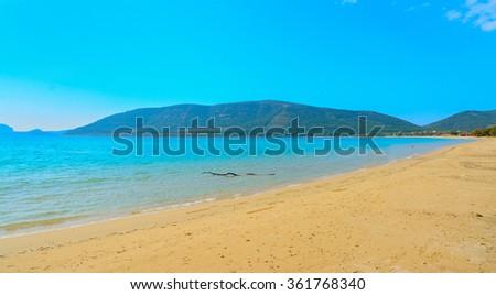 Mugoni beach on a clear day, Sardinia - stock photo