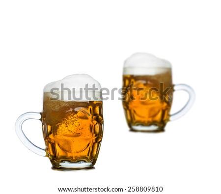 Mugs full of fresh beer isolated on white background - stock photo