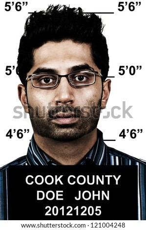 Mugshot of a handsome young man criminal - stock photo