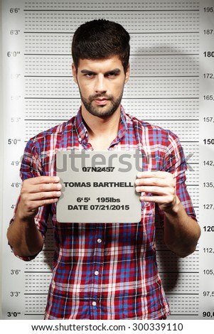Mugshot of jailed criminal - stock photo