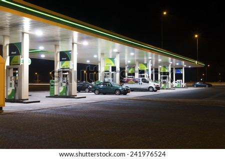 MUIDEN, NETHERLANDS - DECEMBER 28, 2014: BP gas station at night. BP is a petroleum company with its headquarters in London. The company operates in around 80 countries - stock photo