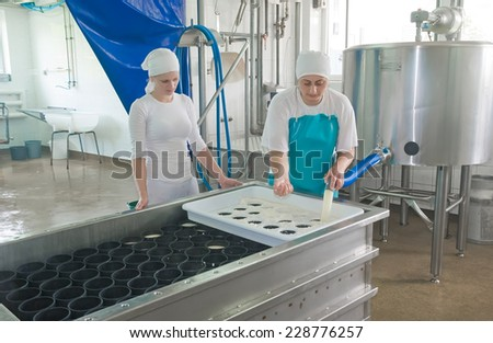 Mukachevo, Ukraine, May 9, 2013: Dairy Worker in a milk shop