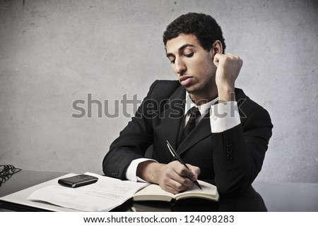 Mulatto businessman calculating some operations