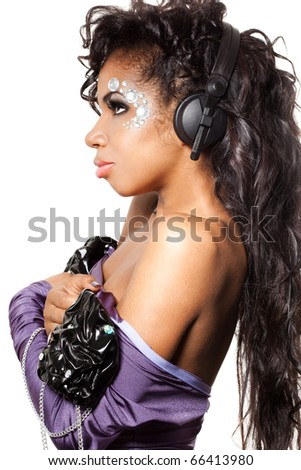 mulatto girl DJ listens music with headphones